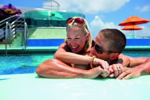 Young couple cruising onboard Carnival Cruises
